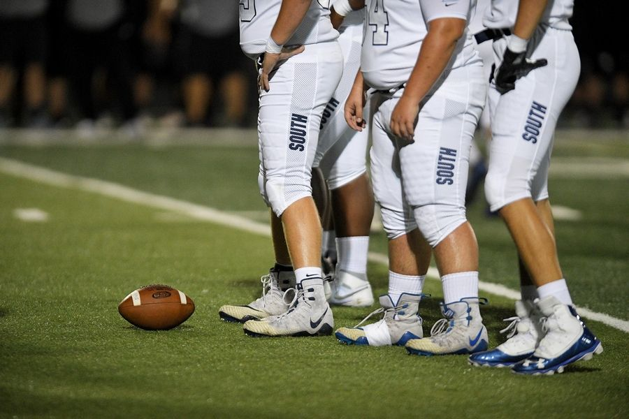 Downers Grove South lineman get ready for a play in a matchup against Willowbrook in Villa Park.