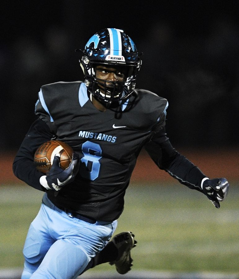 Downers Grove South's Jayden Lambert carries the ball during a game against Downers Grove North.