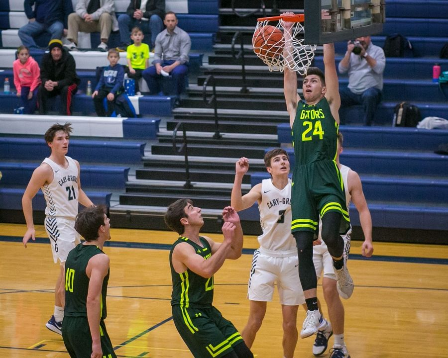 Crystal Lake South forward Damir Glamoc (24) dunks the ball in the second quarter of the game at Cary-Grove High School.