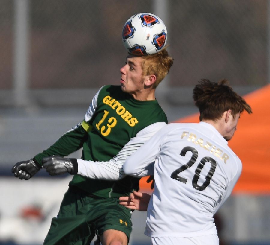 Crystal Lake South's Alex Canfield beats Benet Academy's Evan Frazier to a header in the Class 2A state soccer championship in Hoffman Estates.