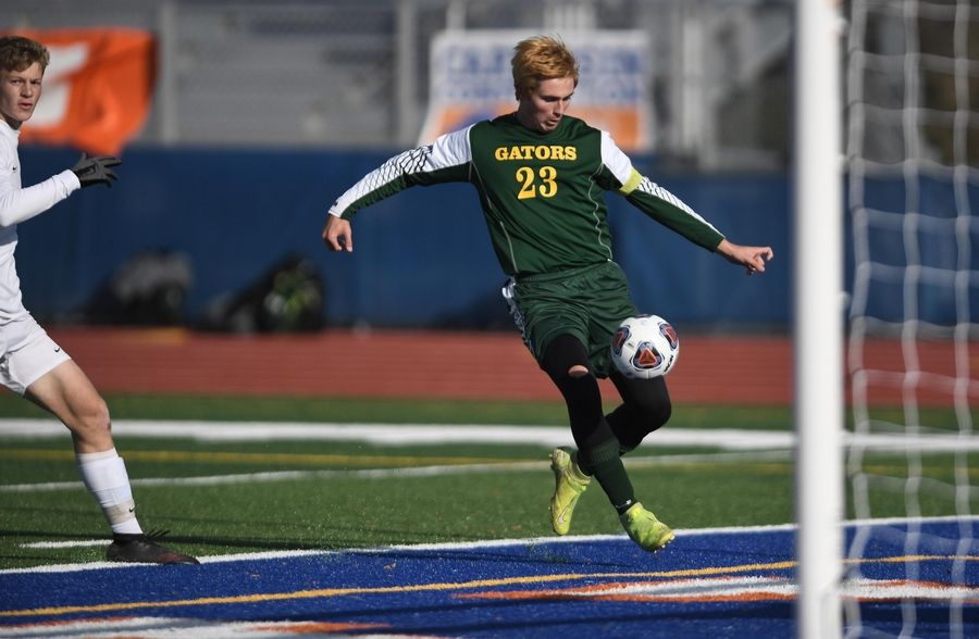 Crystal Lake South's Colton Weidner lines up a shot on the Benet Academy net in the Class 2A state soccer championship in Hoffman Estates.