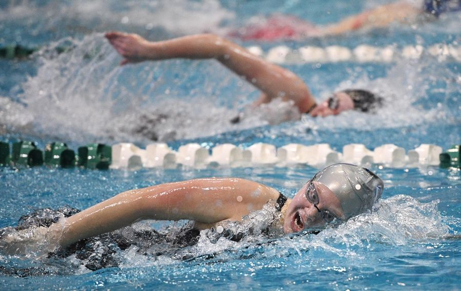Crystal Lake South's Makayla Nietzel wins the Athletes with Disabilities 200-yard freestyle at the girls state swimming championships.