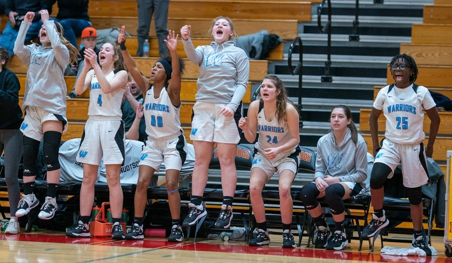 Willowbrook players celebrate after they take the lead late in the fourth quarter of play against Batavia during a semifinal 4A regional.