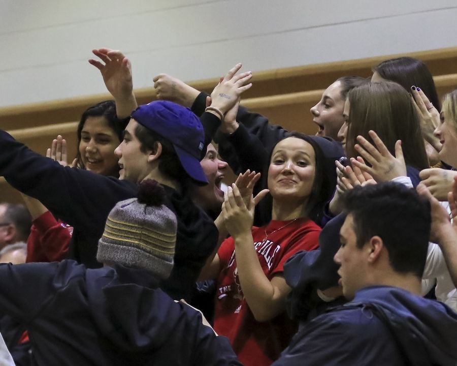 The Willowbrook student section cheers on the team during basketball game against Downers Grove South.