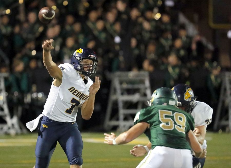 Neuqua Valley's Mark Gronowski, left, throws a pass.