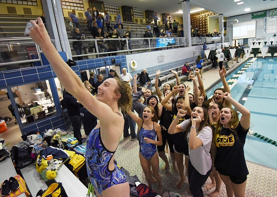 Neuqua Valley team member Jane Riehs stands in the bleachers to take a selfie with her teammates after they won the girls state swimming and diving championship at New Trier High School in Winnetka.
