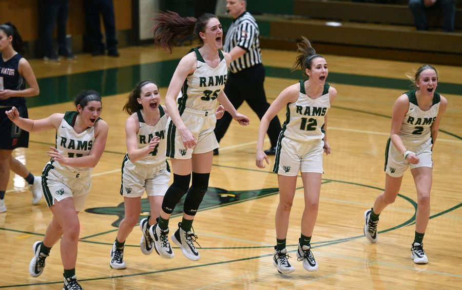 Leaping for joy are Grayslake Central players, from left, Madeline Mussay, MK Drevline, Kate Bullman, Amanda Kocialkowski and Piper Gallaher after the Rams defeated St. Viator in a Class 3A sectional championship girls basketball game.