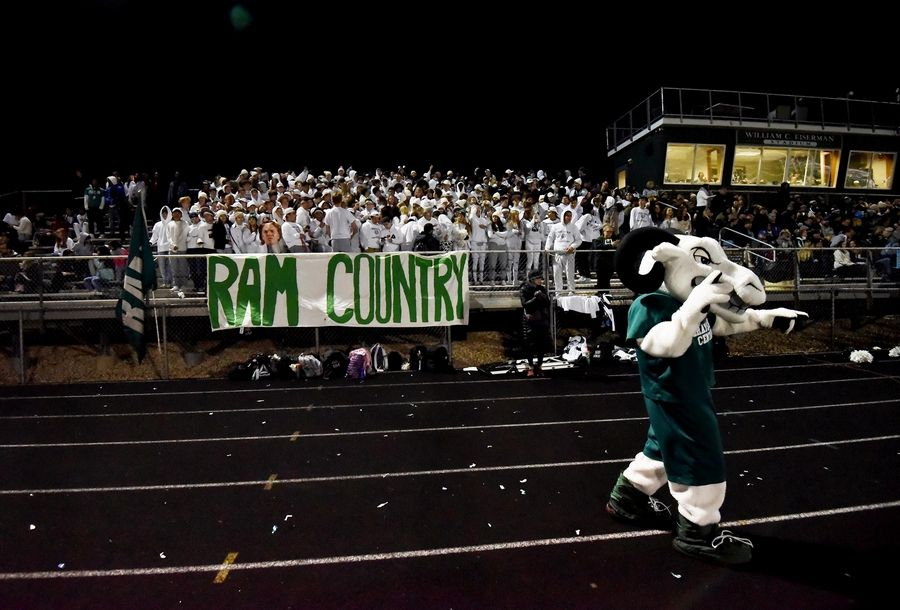 Grayslake Central students get fired up during a football game with rival Grayslake North.