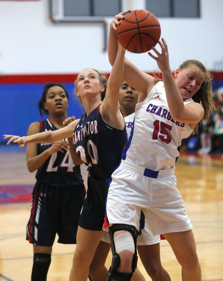 Dundee-Crown High School senior Cassidy Randl (15) battles for a rebound during a home game against Saint Viator.