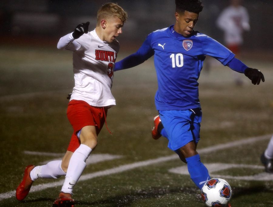 Dundee-Crown High School's Roland Dearborn (10) gets to the ball during a sectional soccer game against Huntley.