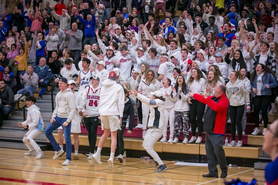 Dundee-Crown students cheer at the final seconds of the fourth quarter of the IHSA Class 4A Huntley Sectional championship game at Huntley High School on Thursday, Feb. 27, 2020, in Huntley, Ill. Dundee-Crown won, 43-37.