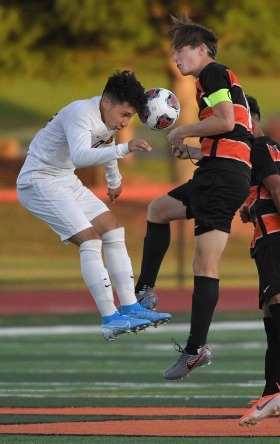 Streamwood's Edwin Peralta and St. Charles East's Geoff Unterberg compete for the ball in a boys soccer game. Peralta was one of the school's boys soccer all-conference athletes.