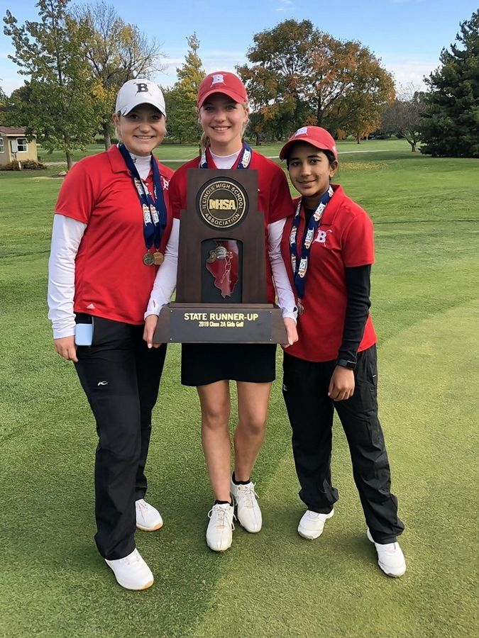 Barrington girls golfers, from left, Caroline Smith, Mara Janess and Sophia Sulkar display the Fillies' state runner-up trophy at Hickory Point Golf Club in Decatur. Janess won the individual championship, while Smith was third and Sulkar fifth.