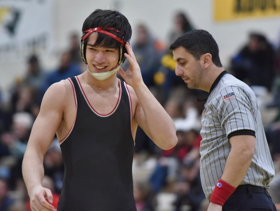 Barrington's Luke Rasmussen smiles after beating Lake Zurich's Dan Hull in their 170-pound championship bout at the Stevenson High School wrestling regional meet.