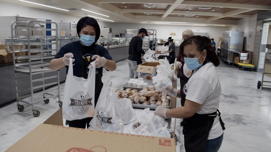 Leyden food staff members prepare and pack lunch and breakfast meals for distribution at seven pickup sites throughout the community. Volunteers help with distribution that takes places from 11 a.m. to noon every weekday.