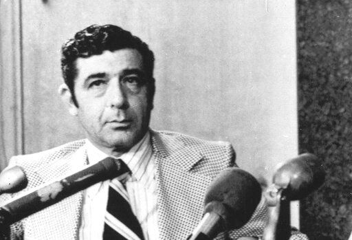 FILE - In this April 2, 1971, file photo, Portland Trail Blazers executive vice president Harry Glickman listens at a news conference as UCLA's Sidney Wicks speaks shortly after signing a five-year contract with the club, in Portland, Ore. Glickman, the founder of the Portland Trail Blazers and general manager of the franchise's only NBA title-winning team in 1977, died Wednesday, June 10, 2020. He was 96. (The Oregonian via AP, File)