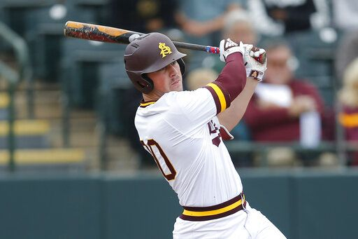 FILE - In this Feb. 17, 2019, file photo, Arizona State's Spencer Torkelson bats during an NCAA college baseball game against Notre Dame in Phoenix. The Detroit Tigers are rebuilding around an impressive group of minor league pitchers. Now, it might be time to add a star hitting prospect to the mix. Whether it's Arizona State slugger Spencer Torkelson or somebody else, Detroit has a chance to add another potential standout when it makes the No. 1 selection in Wednesday night's Major League Baseball draft.