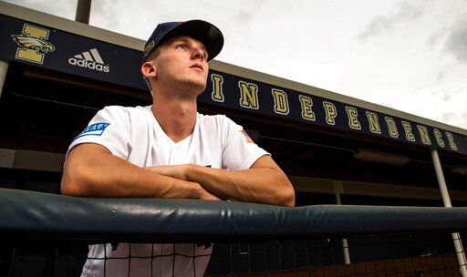 In this Sept. 25, 2019, photo, Independence High School baseball player Robert Hassell III poses for a photo in Thompson's Station, Tenn. Hassell was selected by the San Diego Padres in the baseball draft Wednesday, June 10, 2020. (Wade Payne/The Tennessean via AP)