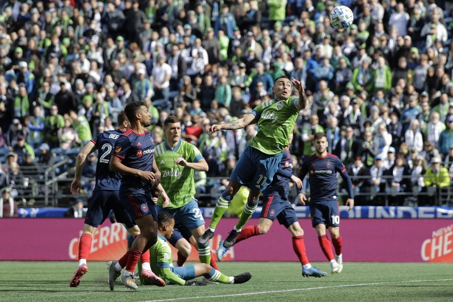 Seattle Sounders defender Miguel Ibarra leaps to head the ball against the Chicago Fire during the first half of the March 1 game in Seattle.