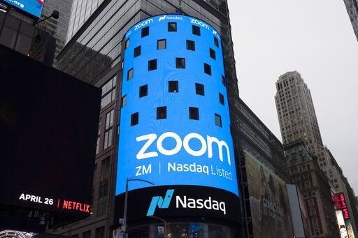 FILE - This April 18, 2019, file photo shows a sign for Zoom Video Communications ahead Nasdaq IPO in New York.  Video app company Zoom said Thursday, June 11 2020, it regretted that some meetings involving U.S.-based Chinese dissidents were disrupted, as meanwhile a prominent Hong Kong activist said his account was blocked despite the city's guarantees of free speech.