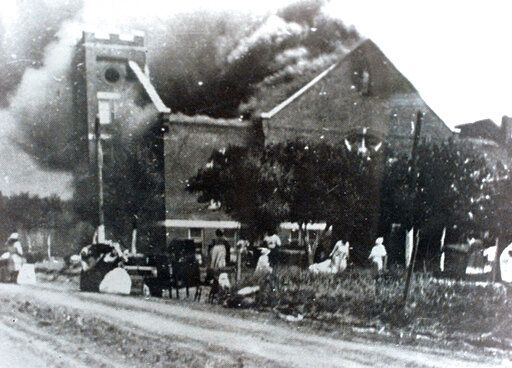 FILE - In this 1921 file image provided by the Greenwood Cultural Center via Tulsa World, Mt. Zion Baptist Church burns after being torched by white mobs during the 1921 Tulsa massacre. Black community and political leaders called on President Donald Trump to at least change the Juneteenth date for a rally kicking off his return to public campaigning, saying Thursday, June 11, 2020. From Sen. Kamala Harris of California to Tulsa civic officials, black leaders said it was offensive for Trump to pick that date - June 19 - and that place - Tulsa, an Oklahoma city that in 1921 was the site of a fiery and orchestrated white-on-black killing spree. (Greenwood Cultural Center via Tulsa World via AP)