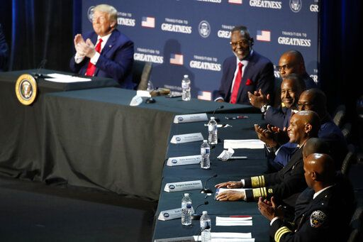 "President Donald Trump applauds as U.S. Surgeon General Jerome Adams speaks during a roundtable discussion about ""Transition to Greatness: Restoring, Rebuilding, and Renewing,"" at Gateway Church Dallas, Thursday, June 11, 2020, in Dallas."