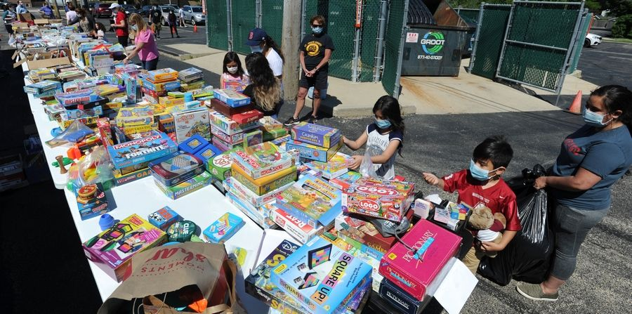 Families Friday filled their bags with toys, school supplies and games that were all donated by parishioners at St. Joseph Catholic Church in Libertyville on Friday. Kids seemed excited as they walked to their cars with bags filled to capacity.