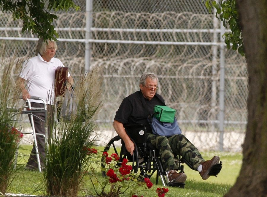 Former Speaker of the House Dennis Hastert, right, reports to the Federal Medical Center in Rochester, Minn., in 2016 to begin serving a sentence for banking violations in a hush-money case.