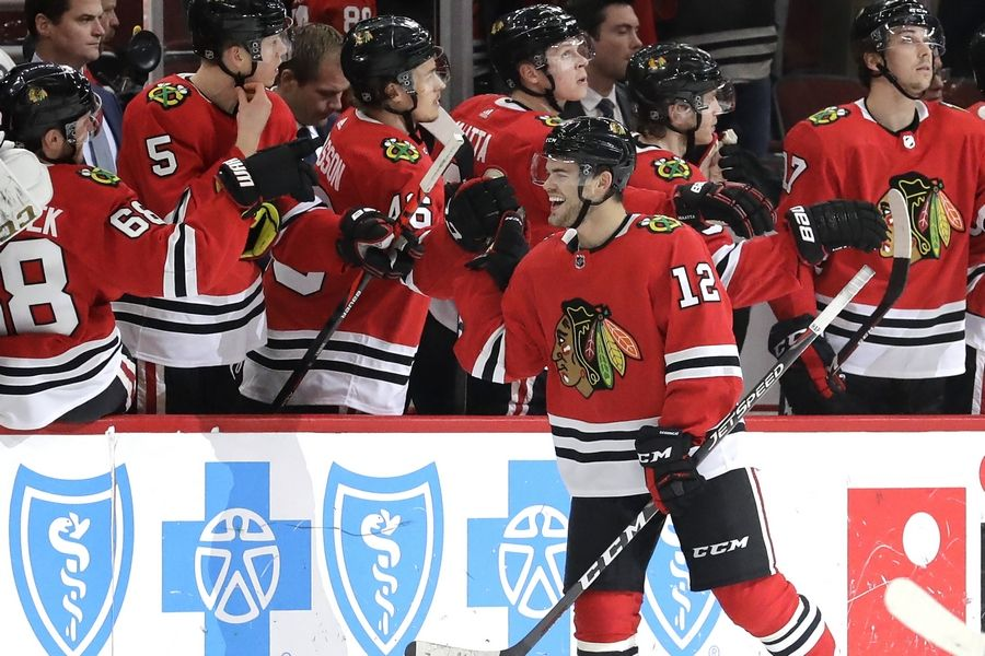 The Blackhawks' Alex DeBrincat celebrates with teammates after scoring during the March 5 win against Edmonton at the United Center.