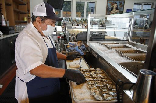 Victor Ek prepares oysters at Mission Rock restaurant on Friday, June 12, 2020, in San Francisco. Today was the first day patio / outdoor dining is allowed in San Francisco restaurants since the COVID-19 pandemic.