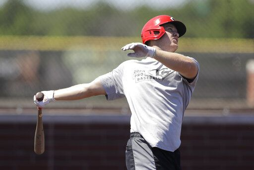 Cincinnati Reds' Josh VanMeter swings during a workout at Grand Park, Friday, June 12, 2020, in Westfield, Ind. Proceeds from the event will go to Reviving Baseball in the Inner City of Indianapolis.