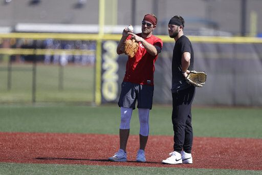 Cincinnati Reds pitcher Justin Shafer, left, talks with Nolan Watson during a workout at Grand Park, Friday, June 12, 2020, in Westfield, Ind. Proceeds from the event will go to Reviving Baseball in the Inner City of Indianapolis.