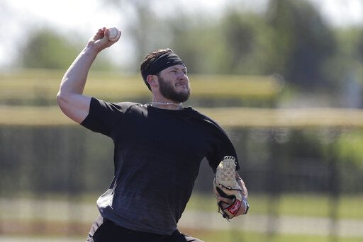 Professional baseball player Nolan Watson throws during a workout at Grand Park, Friday, June 12, 2020, in Westfield, Ind. Professional and college players gathered for a workout with proceeds from the event will go to Reviving Baseball in the Inner City of Indianapolis.