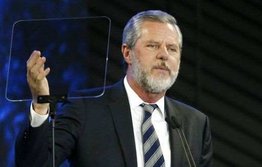 FILE - In this Nov. 28, 2018, file photo, Liberty University President Jerry Falwell Jr. speaks before a convocation at Liberty University in Lynchburg, Va. Nearly three dozen black alumni of Liberty University are denouncing school President Jerry Falwell Jr. on Monday, June 1, 2020, suggesting he step down after he mocked Virginia's mask-wearing requirement by invoking the blackface scandal that engulfed the state's governor last year.