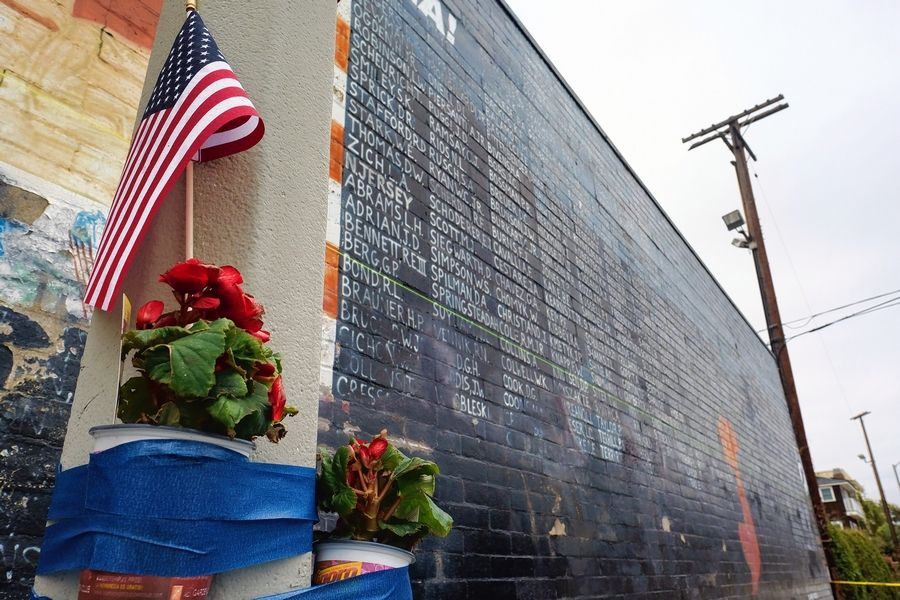 Flowers are left next to a vandalized Vietnam War memorial May 30, 2016, in the Venice area of Los Angeles. Online stories have incorrectly identified images of the LA memorial's 2016 defacement as being of the memorial in Washington, D.C., following George Floyd protests.