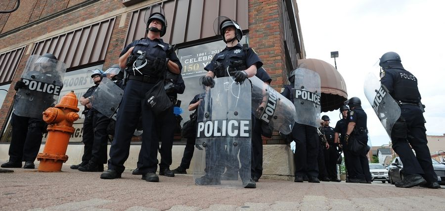 Naperville police were out in force at a recent protest in downtown that started peacefully before vandalism and looting arose.