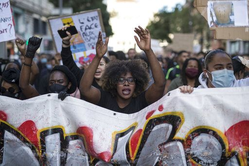 Hawa Traore chants during a march against police brutality and racism in Marseille, France, Saturday, June 13, 2020, organized by supporters of her brother Adama Traore, who died in police custody in 2016. Several demonstrations went ahead Saturday inspired by the Black Lives Matter movement in the U.S.