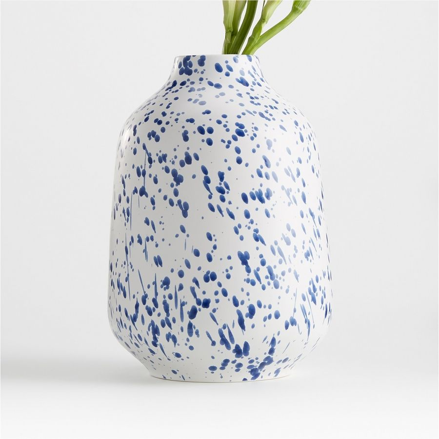 The Alya white speckled vase, $34.95 at crateandbarrel.com, will add a bright note to your desk, even without flowers in it, says designer Loi Thai.