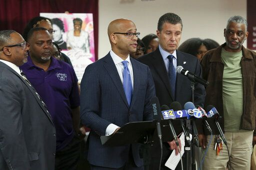 FILE - This June 11, 2019 file photo shows Dwight Gunn, center, son of Verona Gunn speaks during a press conference Tuesday, June 11, 2019, in Chicago. Verona Gunn was an 84-year-old woman killed last May when two Chicago Police vehicles slammed into a car she was riding in. Crashes involving Chicago police vehicles that killed Gunn and a young mother last week, highlight the dangers of police speeding to crime scenes or during car chases. Gunn's son says it's a police reform issue that's not getting the same attention as officers' use of excessive force.