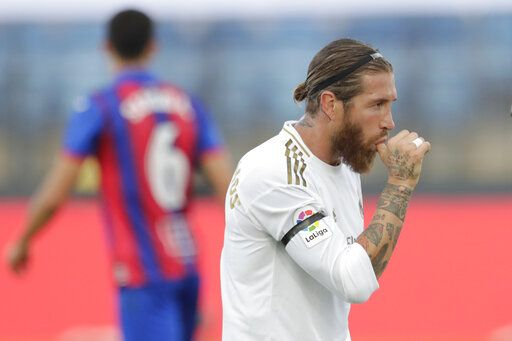 Real Madrid's Sergio Ramos celebrates his goal during the Spanish La Liga soccer match between Real Madrid and Eibar at Alfredo di Stefano stadium in Madrid, Spain, Sunday, June 14, 2020.