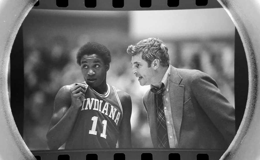 The Daily Herald Archive, Assignment # 57,481, Bob Ringham photo: Indiana University men's basketball coach Bobby Knight talking with future NBA superstar Isiah Thomas, then a sophomore guard, during a game against Northwestern University in Evanston in February of 1981. Indiana went on to win the NCAA tournament by defeating North Carolina in the finals. Isiah Thomas was named the tournament most outstanding player.