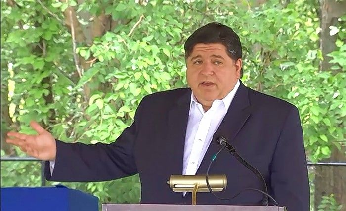 Gov. J.B. Pritzker on Tuesday signed legislation that expands the vote-by-mail program and makes Election Day a state holiday.