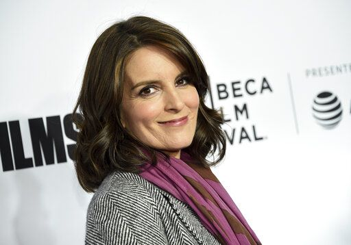 "FILE - In this April 18, 2018 file photo, Tina Fey attends the Tribeca Film Festival world premiere of ""Love, Gilda"" in New York. The cast of ""30 Rock,"" including Fey, Alec Baldwin and Tracy Morgan, will reunite to promote NBCUniversal shows for the 2020-21 season. The hour-long event will air July 16 on the NBC network and also be shown on NBCUniversal cable channels including Bravo and USA Network. (Photo by Evan Agostini/Invision/AP, File)"