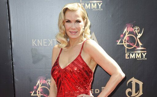 "FILE - In this May 5, 2019 file photo, Katherine Kelly Lang arrives at the 46th annual Daytime Emmy Awards in Pasadena, Calif. ""The Bold and the Beautiful"" plans to resume production Wednesday, becoming the first network scripted show to start shooting again after the long coronavirus layoff. Lang, a longtime star of the show, said on Instagram that she's ""so excited"" to finally return to work. (Photo by Richard Shotwell/Invision/AP, File)"