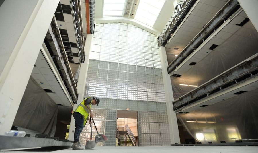 Worker Ari Karbal cleans up inside the former AT&T headquarters in Hoffman Estates. The redevelopment known as Bell Works Chicagoland is expected to have its first office tenants move in within 10 to 12 weeks.