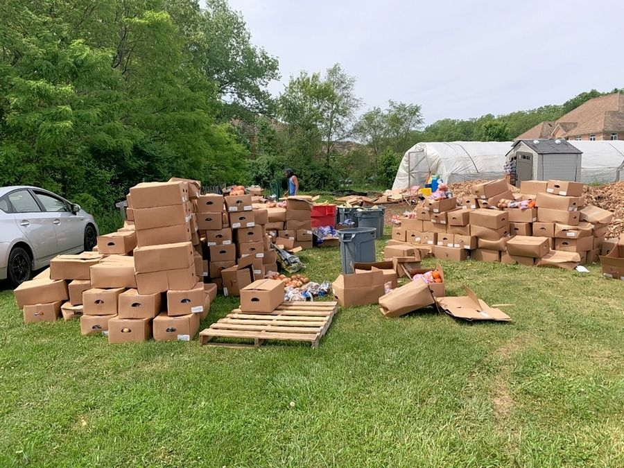 After unloading 10 pallets at the Gurnee American Legion Post 771 Growing Healthy Veterans Hoop House Project, volunteers sorted good food from the spoiled, saving 17,900 pounds from the landfill.