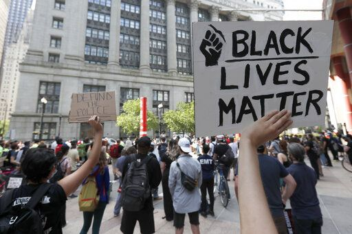 Protesters gather in Thompson Plaza, across the street from Chicago's City Hall, Wednesday, June 17, 2020, demanding that Chicago Mayor Lori Lightfoot enact the ordinance for an all-elected Civilian Police Accountability Council (CPAC) in Chicago.