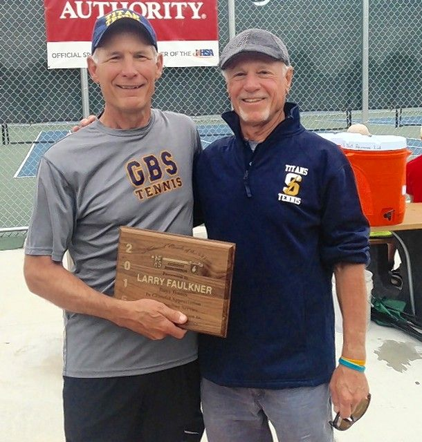 Glenbrook South boys tennis coach Larry Faulkner, left, is joined by Titans assistant coach Bill Lange as Faulkner is presented with the National Federation of State High School Associations' 2015 award for national boys tennis coach of the year.