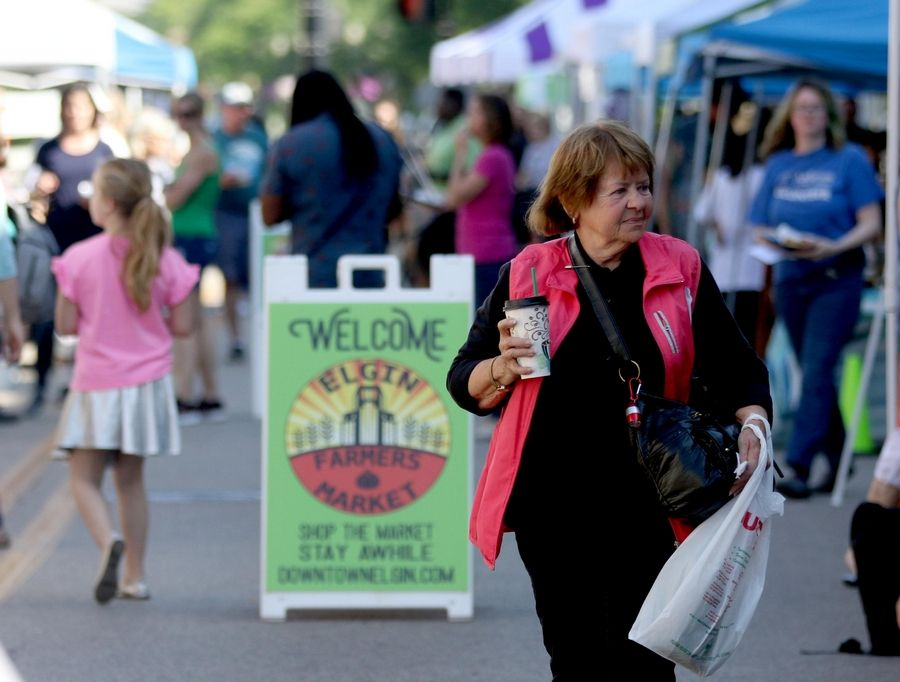 Shoppers browse the Elgin Farmers Market last summer. This year it will be held in a new location, on Spring Street.