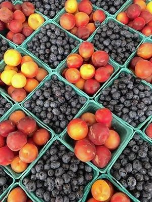 Fresh fruits and vegetables beckon shoppers to outdoor farmers markets this summer, including the Naperville Farmers Market at 5th Avenue Station.